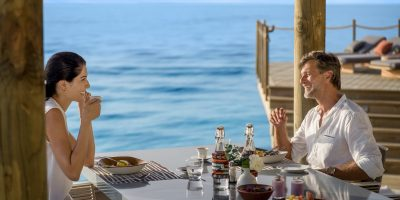 InterContinental Maldives - Couple in villa dining at 3 Bedroom Overwater Residence